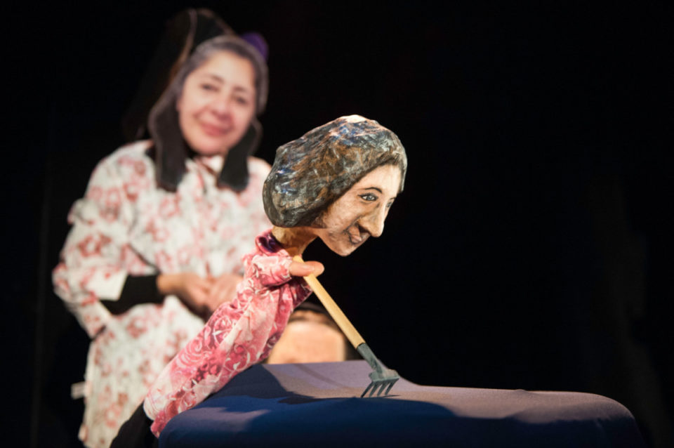 Puppet of Luisa Cabello-Hansel working in a garden.