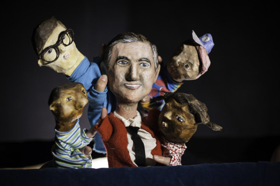 hand puppet versions of Mr. Rogers and neighborhood children.