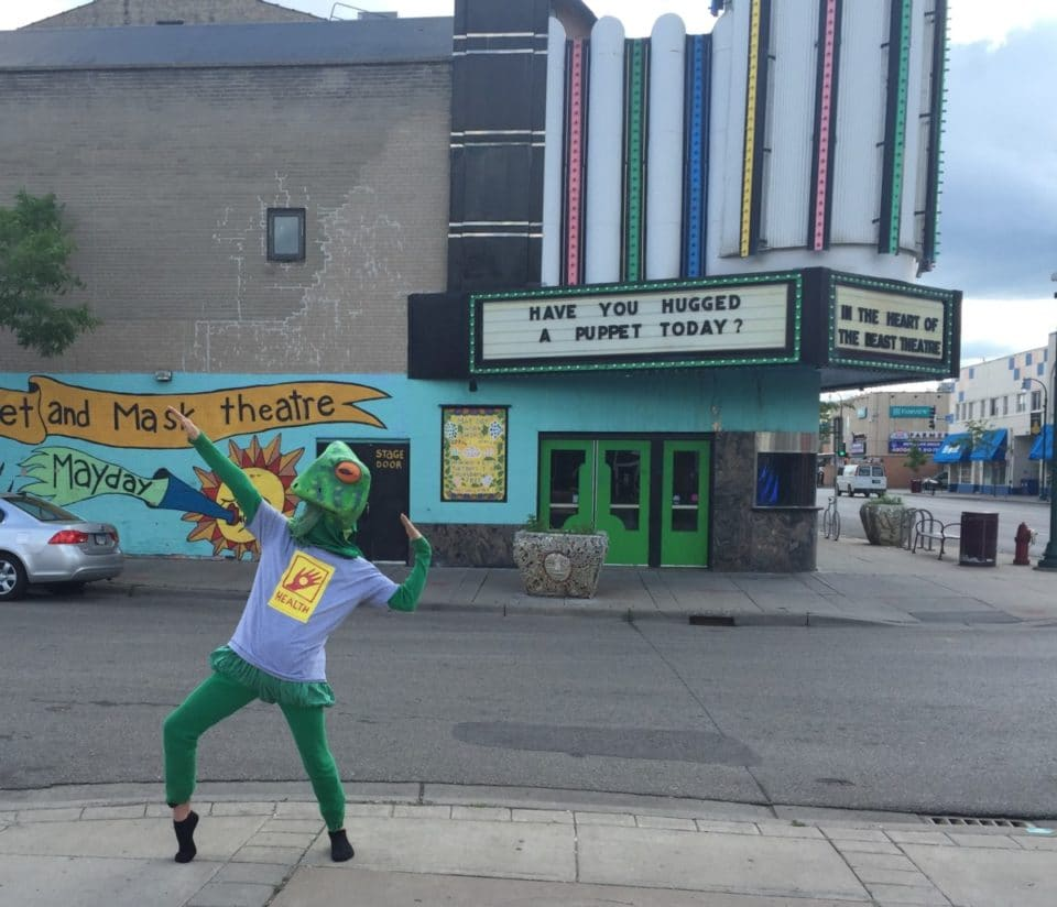Frog modeling Health T-shirt outside of the Avalon Theatre