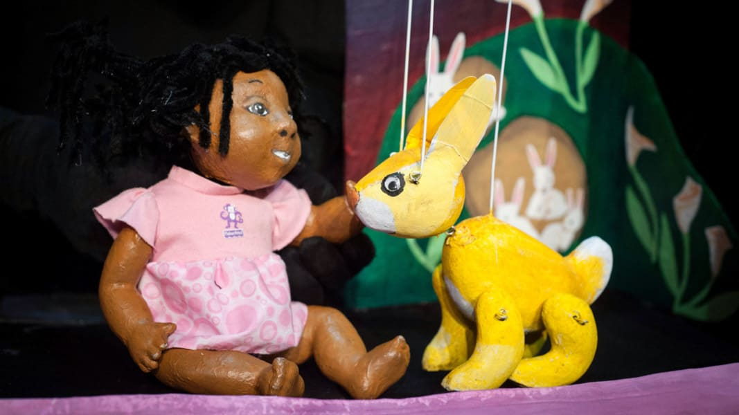 Puppets of a young girl and a rabbit